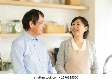 Asian middle-aged couple in the living room