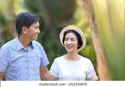 Asian middle-aged man leisure to his wife in valentine day