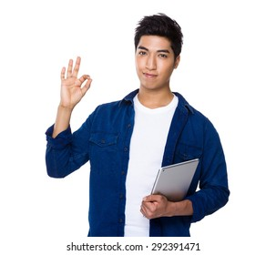 Asian mixed Indian man hold with laptop computer and ok sign gesture