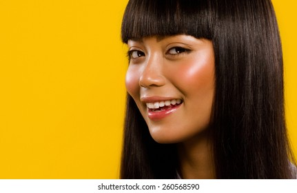 Asian model smiling.