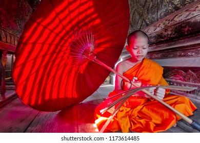 Asian monk novice read a book in  wat mahathat yasothon Sep 02 2018 History of Yasothon,Temples   Thailand.