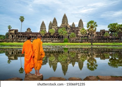 Asian monks stand and look to Angkor wat in siem reap, Cambodia, this image can use for travel and landmark in Asia