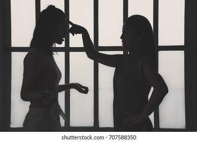 An asian mother are arguing with her teenager daughter