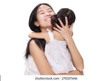Asian Mother and Baby Girl Laughing and Hugging with Love and Happiness.