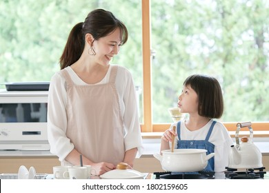 Asian mother and daughter cooking at home
