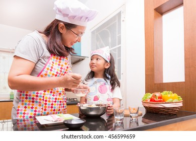 Asian mother and daughter enjoy making Sandwich in kitchen, Sandwich tuna is healthy food which easy to make as activity for family.