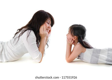 asian mother and daughter lying