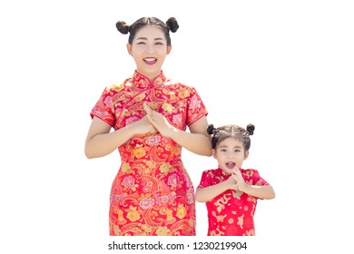 asian mother and daugther greeting action with red cheongsam dress on isolate background. Cheongsam dress use in Chinese new year festival.(Include clipping path)