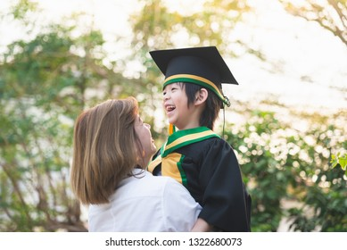 Asian mother embracing her son on graduation day