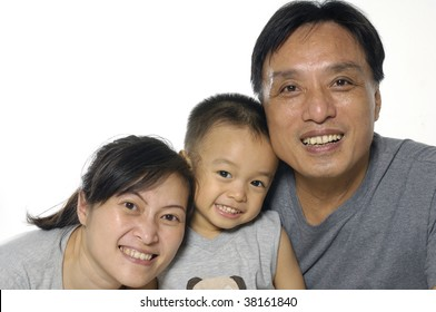 Asian mother, father and little boy. Isolated on white