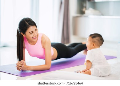 Asian mother fit and play Yoga for lose weight after delivery a new born baby in home, mom, mother, exercise and healthy concept
