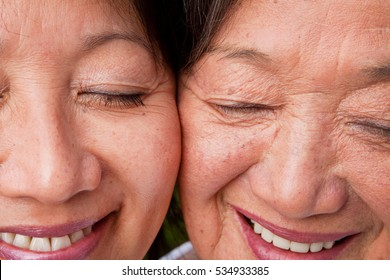 Asian mother and her adult daughter.