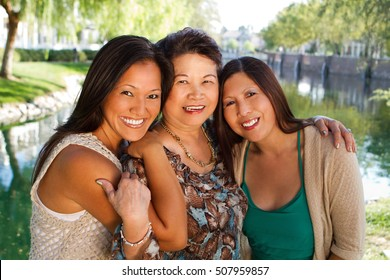 Asian mother and her adult daughters.