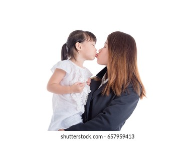 Asian mother and her daughter kissing over white background