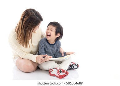 Asian mother and her son reading a book together on white background isolated