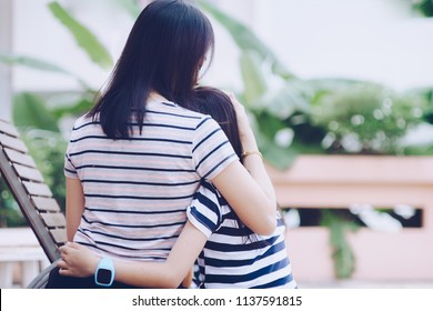 Asian Mother Hugging Daughter with love and feel warm.
