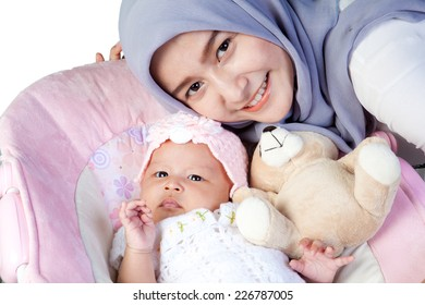 Asian Mother Muslim with her newborn baby girl