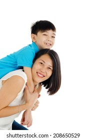 Asian mother piggyback her son