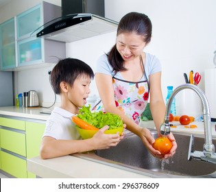 Asian mother and son in the kitchen