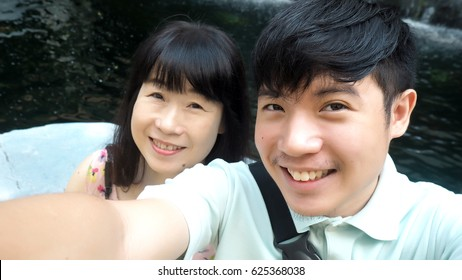 Asian mother and son take selfie