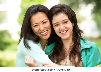 Asian mother and teenage daughter.