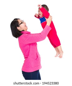 Asian mother throwing with son