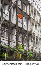Asian multi-storey house with wires and mold