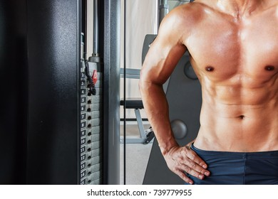 Asian Muscle man in a gym. Attractive fitness man in gym, trained male body. lifestyle portrait. Sport man in gym. Sport and fitness concept.