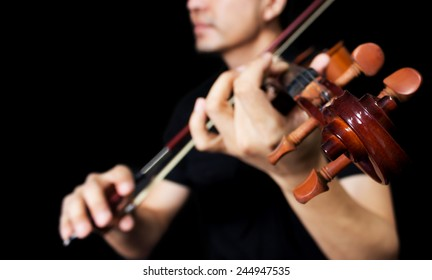 asian musician playing vintage classical violin, isolated on black for music background