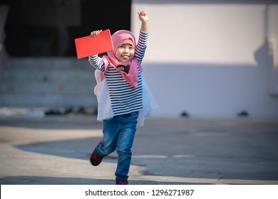 Asian Muslim child girl is happy for going to school. education concept.