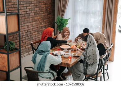 asian muslim family break fasting together in dining room