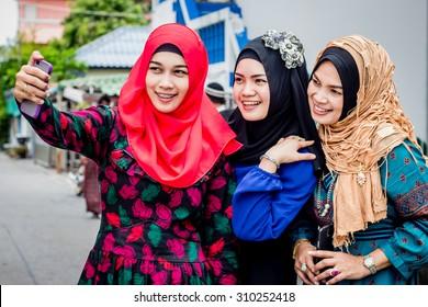 Asian Muslim girl taking selfie
