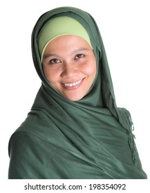 An Asian Muslim Malay woman with green hijab over white background