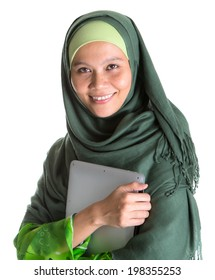 An Asian Muslim Malay woman with green hijab and a laptop over white background