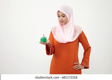 Asian Muslim Malay woman with tudung over white background