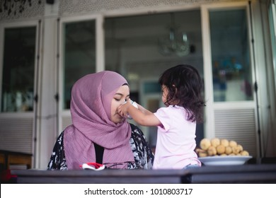 Asian Muslim mother spent her holiday time with lovely daughter. Cute family and relationship concept