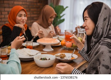 asian muslim people having dinner break fasting together at home during ramadan