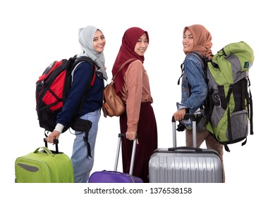 asian muslim woman eid mubarak travelling concept. friend with hijab and suitcase over white background