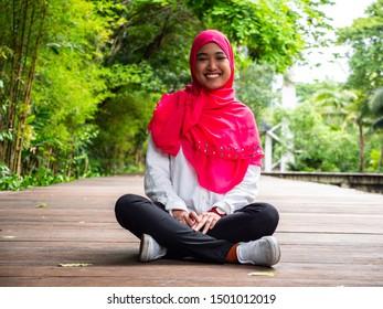 Asian muslim woman portrait in the outside.