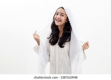 Asian Muslim woman smiling wearing a veil in white background