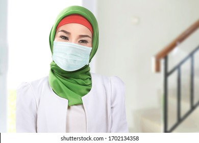 Asian Muslim woman in a veil and wearing a flu mask. Prevent the spread flu disease Coronavirus