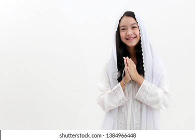 Asian Muslim woman welcoming guests / Ied Fitr Greeting in white background