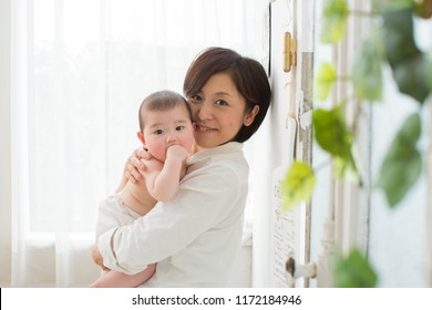 asian new born baby with mom