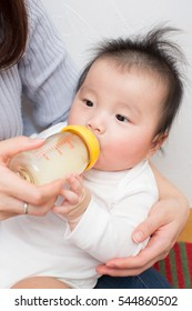 asian newborn baby drinking milk