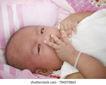 Asian newborn baby girl lying on bed, Blur effect form the camera