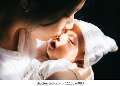 Asian newborn baby in his mother arms
