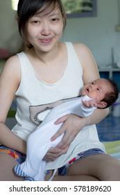 Asian newborn baby and mom
