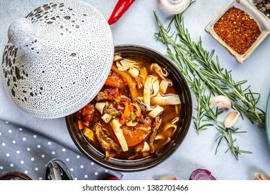 asian noodle soup with beef meatball with fresh vegetable on wood table vintage style