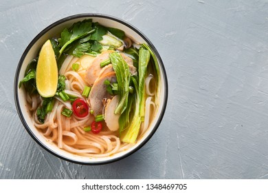 Asian noodle soup Pho bo. Top view with copy space