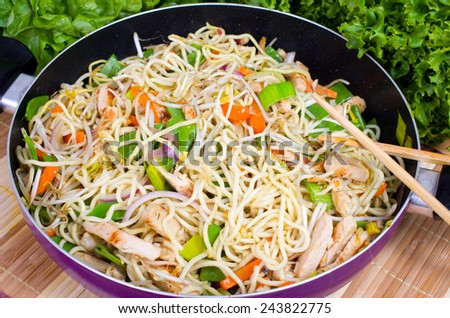 Asian Noodles with colorful vegetables and chicken